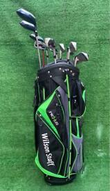 Full set of Wilson golf clubs irons drivers and cart bag