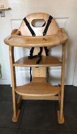 A beautiful solid wood highchair
