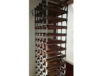 72 Hole Wine Rack. Wood and metal. 1755x420mm