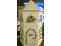 free doll house 30cm tall approx and 10 wide