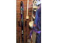 Salomon skis, bindings, poles and bag