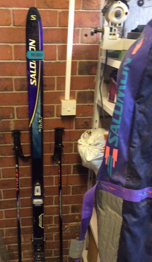 Salomon skis, poles and bag