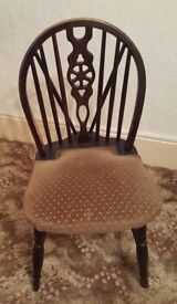 Pair of solid dark oak antique wheel back dining chairs.