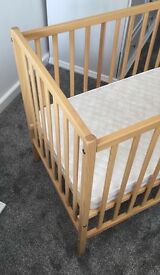 Compact Cot and Mattress great for space saving or people struggling for room