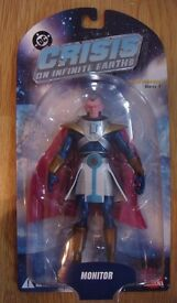Crisis on Infinite Earth Monitor action figure still in box and unopened.