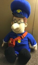 Postman Pat large soft toy.