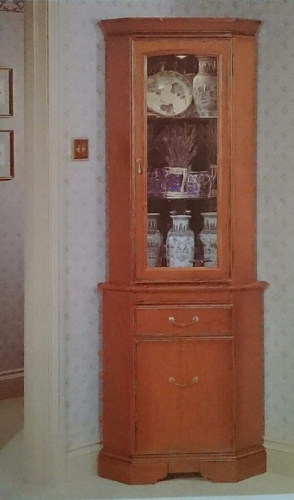 Corner cabinet display and storage space john e coyle for John e coyle dining room furniture