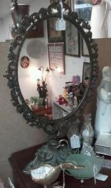 Old metal framed stand alone mirror