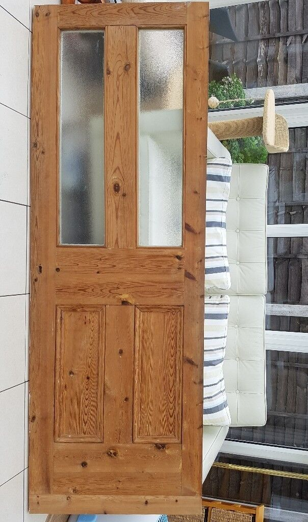 Interior Door, wooden with glass panels. One side painted white, one side waxed