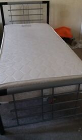Selling 1 single metal beds, new firm mattresses, bought less than year ago,under warranty with bill