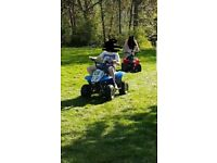 Two 50cc quad bikes. Blue and white is automatic smaller red one is 4 speed crash gear box.