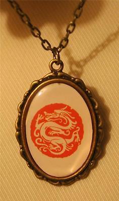 Lovely Flute Rim Brasstne Peach Cream Oriental Good Luck Dragon Pendant Necklace