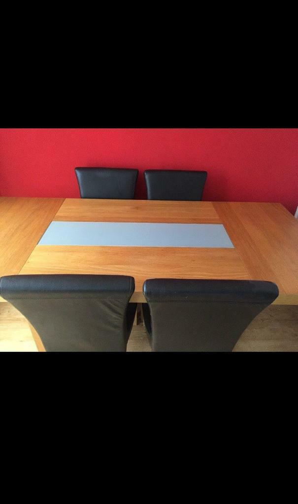 Table and 4 faux leather chairs