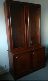 Victorian mahogany cabinet with two glazed door bookcase section above