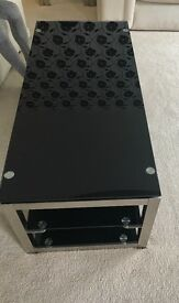 Black and steel glass coffee table with shelf
