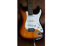 Encore electric guitar unmarked in gig bag.