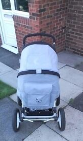 Grey pram with covers