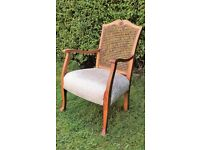 Antique caned chair; newly re-upholstered