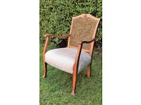 Antique re-upholstered caned chair
