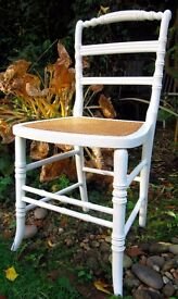 Up-cycled decorative chair with rattan seat.