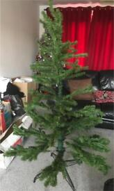 Artificial Christmas tree complete with baubles, lights, angel