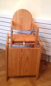 Light wood high chair which also turns into a chair and table top.