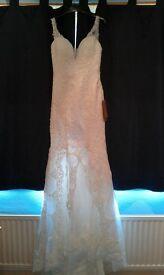 Ivory wedding dress- unworn-tried on once.