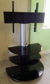 """TV Stand up to 50"""" Swivels with 3 Shelves striking black and silver"""