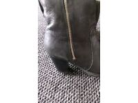 black leather boots in size 7.