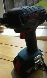 Brand new cordless Bosch Impact Drill and battery
