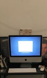 iMac 20.5 inches with keyboard and mouse