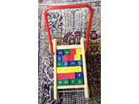 CHILDS BRICK TROLLEY WITH EDUCATIONAL BRICKS.