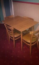 OBLONG DINING TABLE WITH FOUR CHAIRS GOOD CONDITION PHONE CALLS ONLY NO CREDIT TO REPLY