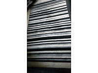 Black, white and grey striped rug for sale. Owned just over a year. Good quality.