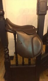 "Synthetic saddle adjustable gullet, currently medium width, 17"" seat"