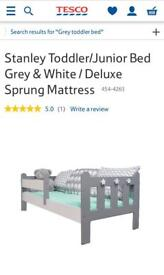 Grey toddler bed with mattresses