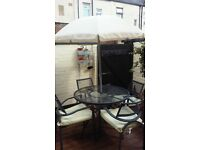 patio set, cushions and umbrella,little bit of rust with being outside,very comfortable