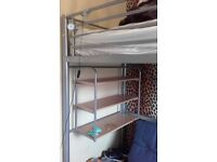 Childs steel frame Hi sleeper bed with desk and shelf fitted plus futon single bed for sleep overs.