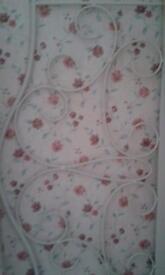 Single, white, wrought iron bed