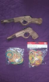2 wooden rubber band toy guns with rubber bands