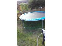 Large trampoline with safety side net.10 ft outer diameter.