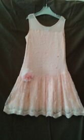 Salmon coloured sequin lace party dress. Suit age 9 - 10 years. Excellent condition. £3.00
