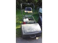 """Webb Cylinder Lawnmower, with seat and rear roller Honda engine 24"""" cut."""