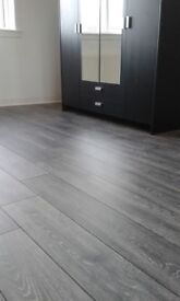 8mm Winter Grey and charcoal grey laminate flooring fully fitted 5x4 20m2 Underlay beading fitting