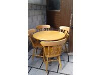 Solid oak table & 4 chairs...good condition