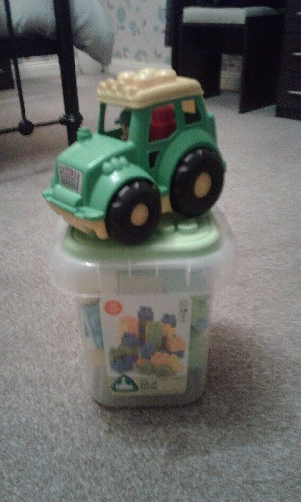 Early learning building blocks and mega blocks tractor