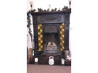 Cast iron black fire surround with mantle piece, grate and ash tray