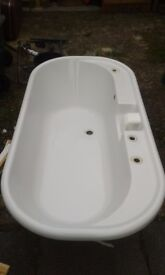 Large inset double-ended bath