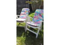 2 solid upvc reclining chairs with padded cushions