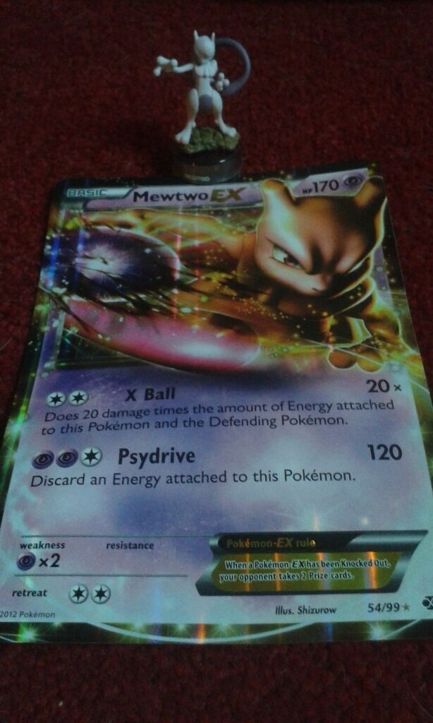 Large Mewtwo pokemon card and figure